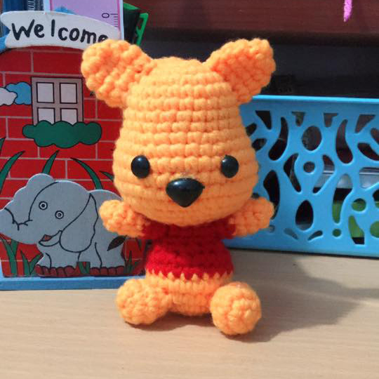 The amigurumi definition is a crocheted or knitted stuffed doll